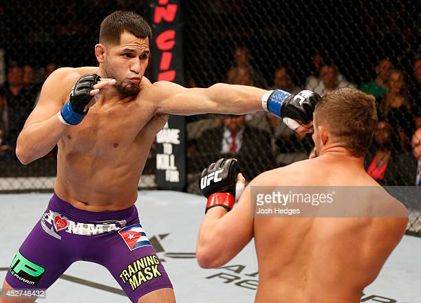 Jorge Masvidal punches Daron Cruickshank in their lightweight bout during the UFC Fight Night event at SAP Center on July 26 2014 in San Jose...