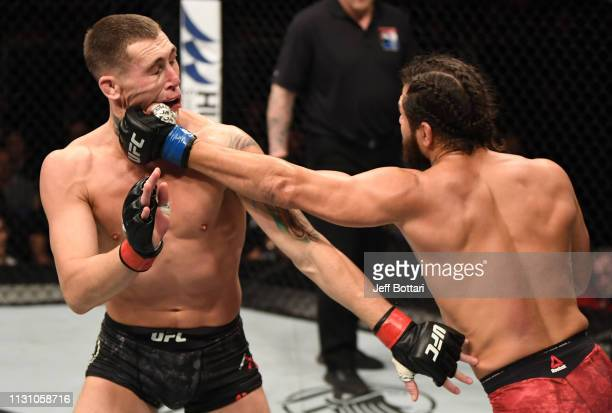 Jorge Masvidal punches Darren Till of England in their welterweight bout during the UFC Fight Night event at The O2 Arena on March 16 2019 in London...
