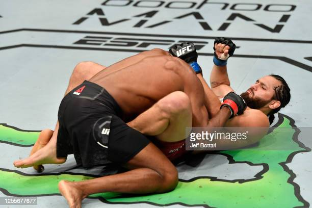 Jorge Masvidal punches Kamaru Usman of Nigeria from his back in their UFC welterweight championship fight during the UFC 251 event at Flash Forum on...