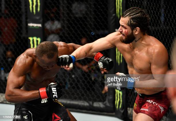 Jorge Masvidal punches Kamaru Usman of Nigeria in their UFC welterweight championship fight during the UFC 251 event at Flash Forum on UFC Fight...