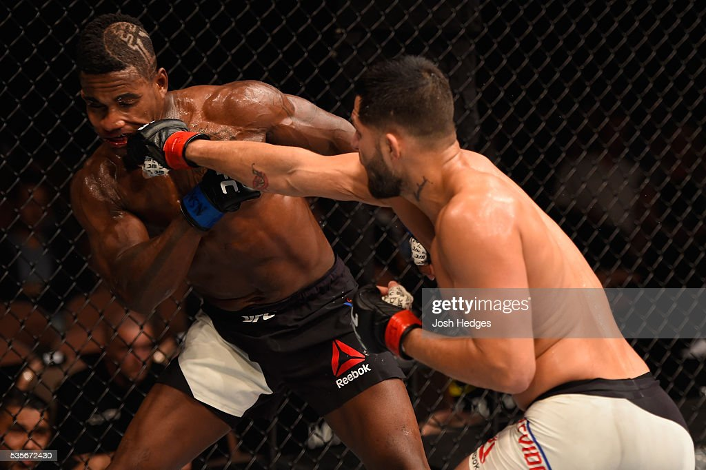 Jorge Masvidal punches Lorenz Larkin in their welterweight bout during the UFC Fight Night event inside the Mandalay Bay Events Center on May 29, 2016 in Las Vegas, Nevada.