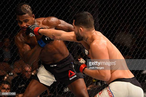 Jorge Masvidal punches Lorenz Larkin in their welterweight bout during the UFC Fight Night event inside the Mandalay Bay Events Center on May 29 2016...