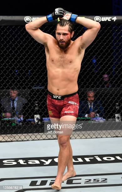 Jorge Masvidal returns to his corner between rounds of his UFC welterweight championship fight against Kamaru Usman during the UFC 251 event at Flash...