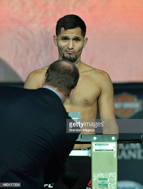 Jorge Masvidal steps onto the scale during the TUF 21 Finale Weighin at the UFC Fan Expo in the Sands Expo and Convention Center on July 11 2015 in...