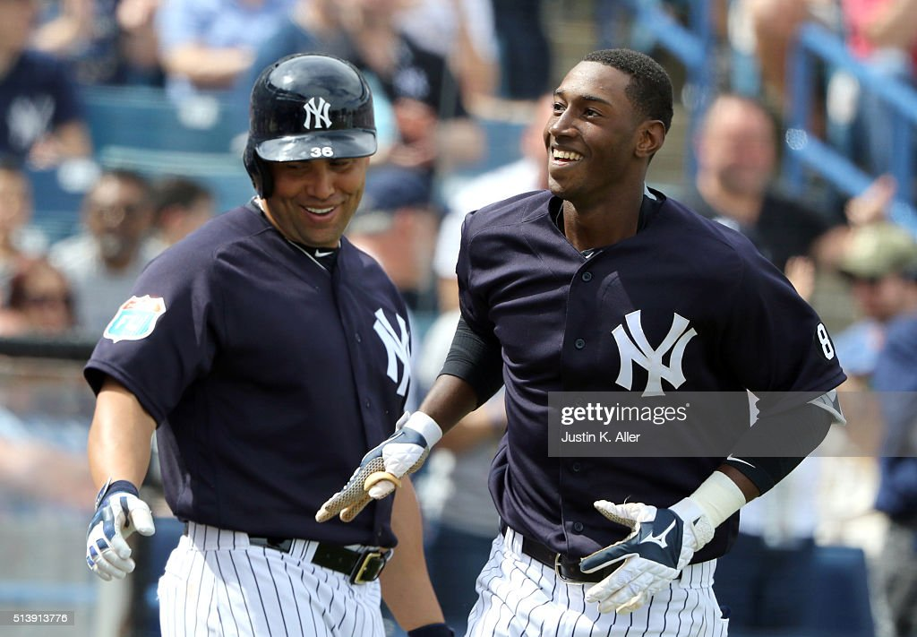Jorge Mateo #93 of the New York Yankees celebrates with Carlos Beltran #36 after hitting a solo home run in the third inning during the game against the Boston Red Sox at George M. Steinbrenner Field on March 5, 2016 in Tampa, Florida.