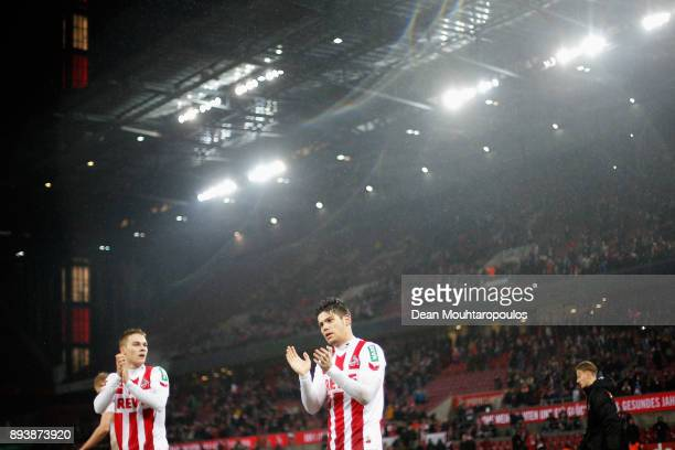Jorge Mere and Tim Handwerker of FC Koeln celebrate victory after victory in the Bundesliga match between 1 FC Koeln and VfL Wolfsburg at...