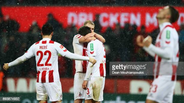 Jorge Mere Frederik Sorensen and Dominique Heintz of FC Koeln celebrate after victory in the Bundesliga match between 1 FC Koeln and VfL Wolfsburg at...