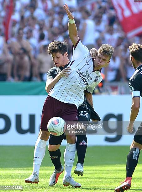 Jorge Mere of FC Koeln and Mateusz Lewandowski of BFC Dynamo battle for the ball during the DFB Cup first round match between BFC Dynamo and 1 FC...