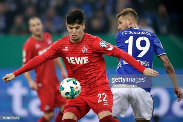 Jorge Mere of FC Koln Guido Burgstaller of Schalke 04 during the German DFB Pokal match between Schalke 04 v 1 FC Koln at the Veltins Arena on...