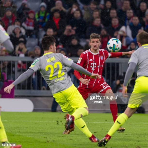 Jorge Mere of Koeln and Arturo Vidal of Muenchen battle for the ball during the Bundesliga match between FC Bayern Muenchen and 1 FC Koeln at Allianz...