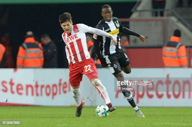 Jorge Mere of Koeln and Denis Zakaria of Moenchengladbach battle for the ball during the Bundesliga match between 1 FC Koeln and Borussia...