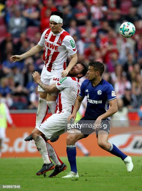 Jorge Mere of Koeln and Franco di Santo of Schalke battle for the ball during the Bundesliga match between 1 FC Koeln and FC Schalke 04 at...