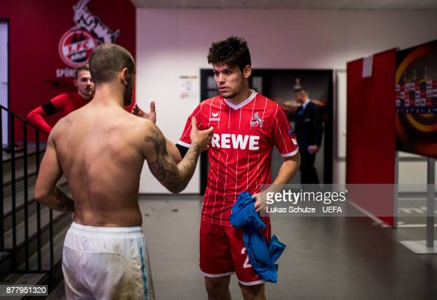 Jorge Mere of Koeln and Jack Wilshere of Arsenal change their jerseys after the UEFA Europa League group H match between 1 FC Koeln and Arsenal FC at...