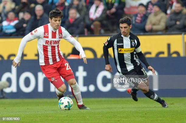 Jorge Mere of Koeln and Lars Stindl of Moenchengladbach battle for the ball during the Bundesliga match between 1 FC Koeln and Borussia...