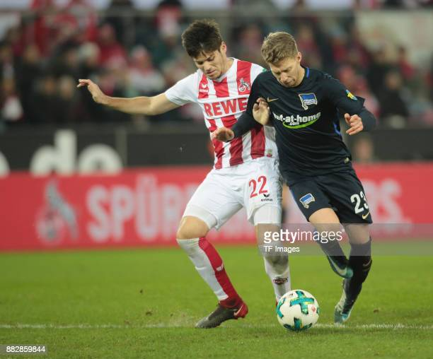 Jorge Mere of Koeln and Mitchell Weiser of Hertha BSC Berlin battle for the ball during the Bundesliga match between 1 FC Koeln and Hertha BSC at...