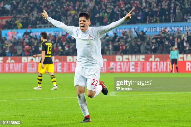 Jorge Mere of Koeln celebrates after scoring his team`s second goal during the Bundesliga match between 1 FC Koeln and Borussia Dortmund at...