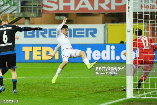 Jorge Mere of Koeln scores gainst Leopold Zingerle of Paderborn during the Bundesliga match between SC Paderborn 07 and 1 FC Koeln at Benteler Arena...