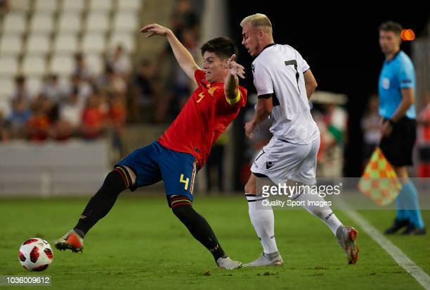 Jorge Mere of Spain competes for the ball with Taulan Sulejmanov of Albania during the 2019 UEFA Under 21 qualifier match between Spain U21 and...