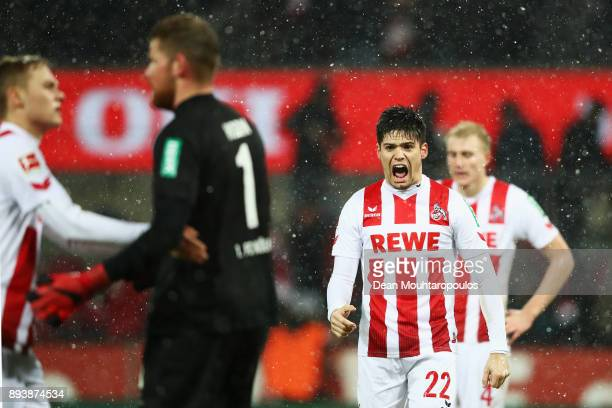 Jorge Mere Timo Horn and Tim Handwerker of FC Koeln celebrate after victory in the Bundesliga match between 1 FC Koeln and VfL Wolfsburg at...