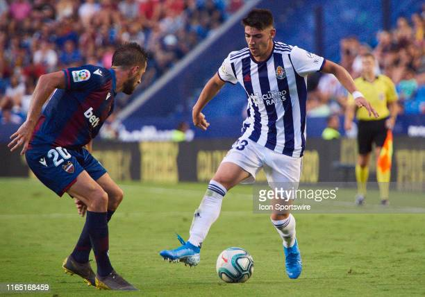 Jorge Miramon, defender of Levante UD competes for the ball with Anuar Mohamed Tuhami, midfielder of Real Valladolid CF during the La Liga match...