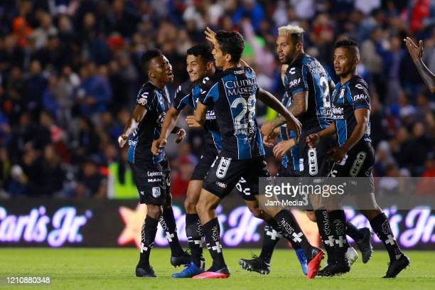Jorge Miranda of Queretaro celebrates with teammates after scoring the first goal of his team during the 9th round match between Queretaro and Toluca...