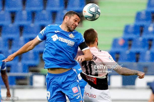 Jorge Molina of FC Getafe and Sergi Darder of Espanyol Barcelona battle for the ball during the Liga match between Getafe CF and RCD Espanyol at...