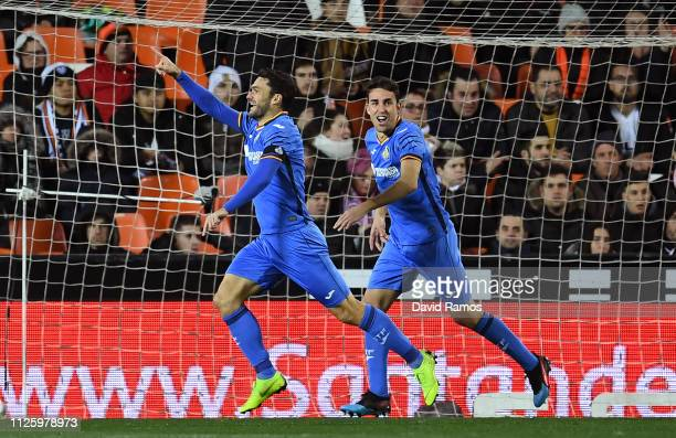 Jorge Molina of Getafe celebrates scoring his side's first goal during the Copa del Rey Quarter Final match between Valencia and Getafe at Estadio...