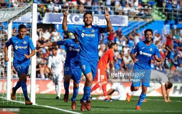 Jorge Molina of Getafe celebrates scoring his team's first goal during the La Liga match between Getafe and Real Madrid at Estadio Coliseum Alfonso...