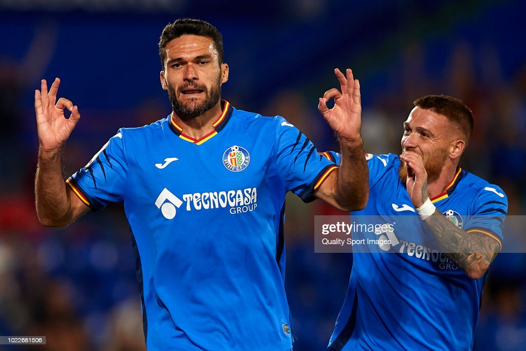 Jorge Molina (L) of Getafe CF celebrates scoring his team's second goal with Gabriel Antunes during the La Liga match between Getafe CF and SD Eibar at Coliseum Alfonso Perez on August 24, 2018 in Getafe, Spain.