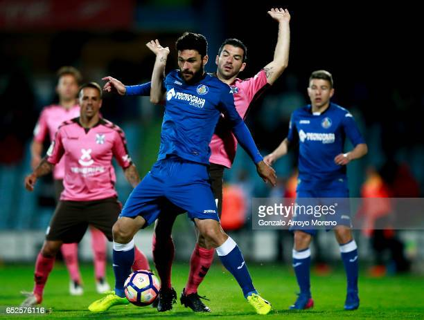 Jorge Molina of Getafe CF competes for the ball with Inaki Saenz of CD Tenerife during the La Liga second league match between Getafe CF and CD...
