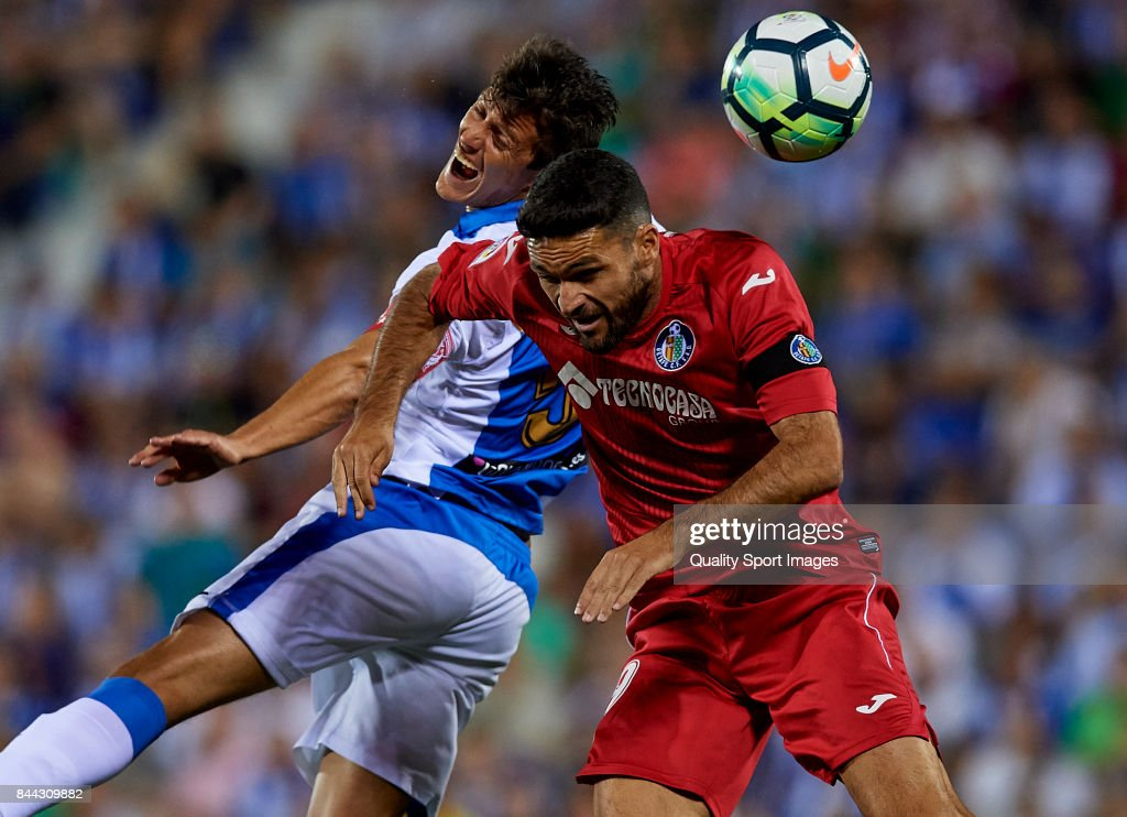 Jorge Molina of Getafe competes for the ball with Martin Maximiliano Mantovani (L) of Leganes during the La Liga match between Leganes and Getafe at Estadio Municipal de Butarque on September 8, 2017 in Leganes, Spain.