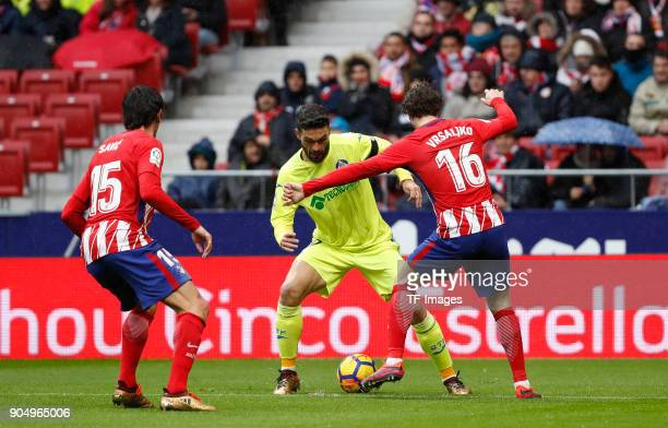 Jorge Molina of Getafe Savic of Atletico Madrid and Vrsaljko of Atletico Madrid battle for the ball during the La Liga match between Atletico Madrid...