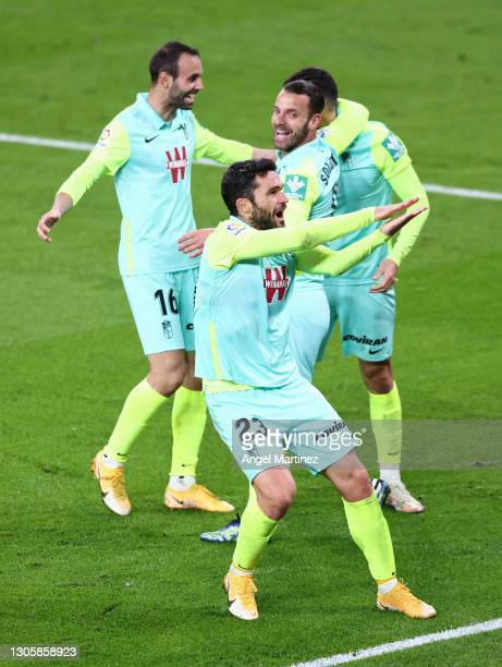 Jorge Molina of Granada CF celebrates with Victor Diaz and Roberto Soldado after scoring their side's first goal during the La Liga Santander match...