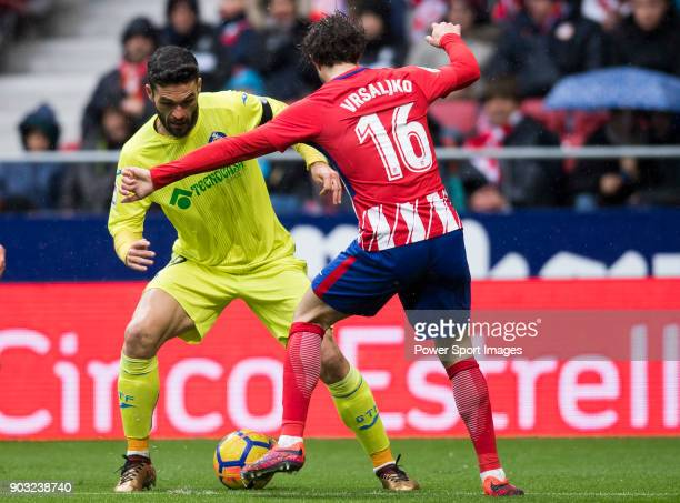 Jorge Molina Vidal of Getafe CF competes for the ball with Sime Vrsaljko of Atletico de Madrid during the La Liga 201718 match between Atletico de...