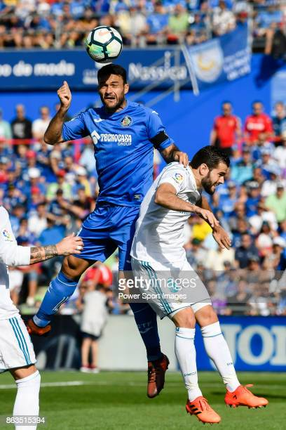 Jorge Molina Vidal of Getafe CF fights for the ball with Jose Ignacio Fernandez Iglesias Nacho of Real Madrid during the La Liga 201718 match between...