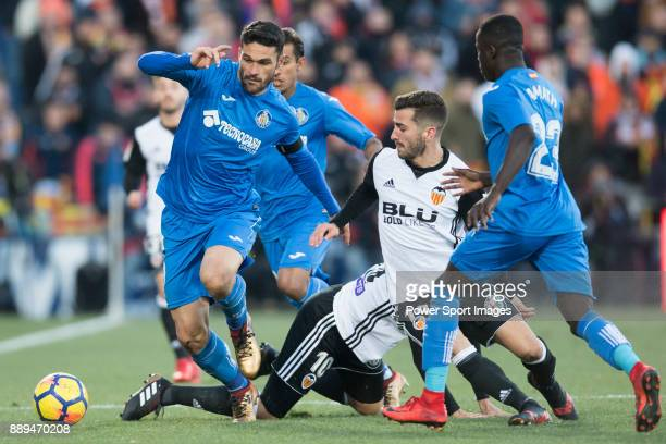 Jorge Molina Vidal of Getafe CF in action against Jose Luis Gaya Pena of Valencia CF and Daniel Parejo Munoz of Valencia CF during the La Liga 201718...