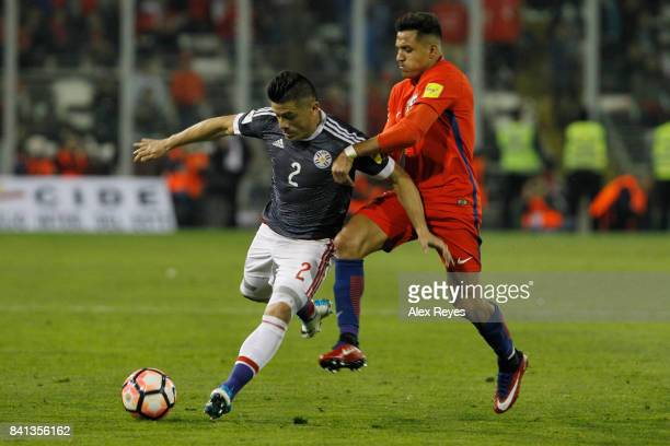 Jorge Moreira of Paraguay fights for the ball with Alexis Sanchez of Chile during a match between Chile and Paraguay as part of FIFA 2018 World Cup...