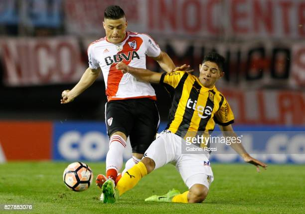 Jorge Moreira of River Plate fights for the ball with Antonio Marin of Guarani during a second leg match between River Plate and Guarani as part of...