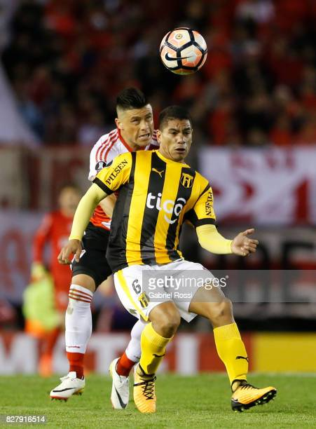 Jorge Moreira of River Plate fights for the ball with Rodolfo Gamarra of Guarani during a second leg match between River Plate and Guarani as part of...