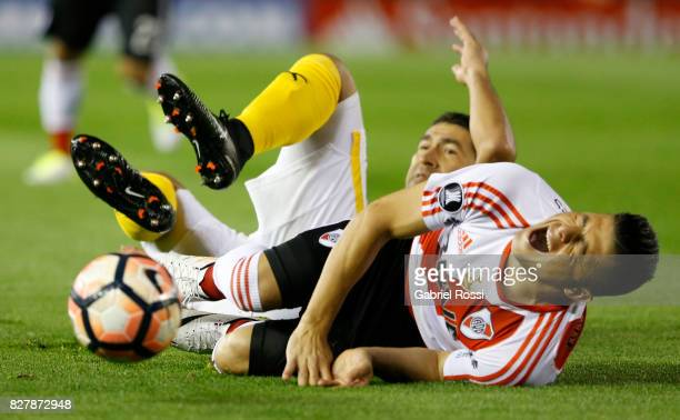 Jorge Moreira of River Plate laments after being fouled by Luis Alberto Cabral of Guarani during a second leg match between River Plate and Guarani...