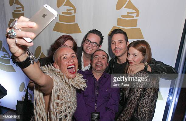 Jorge Moreno and guest attend the 57th Annual GRAMMY Awards Telecast Viewing Party at Cinepolis Grove 13 Theaters on February 8, 2015 in Coconut...