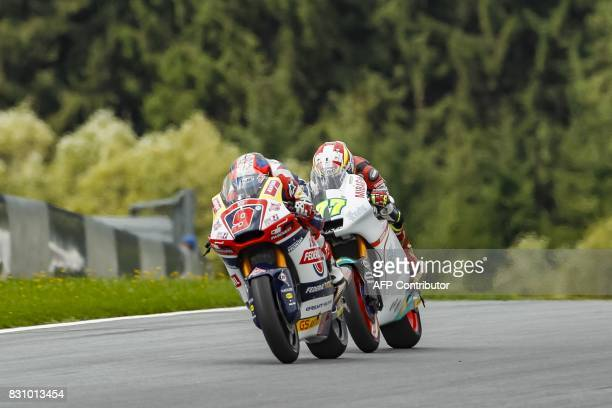 Jorge Navarro of Spain and Dominique Aegerter of Switzerland compete during the Moto 2 race of the Austria Moto Grand Prix on August 13 in Spielberg...