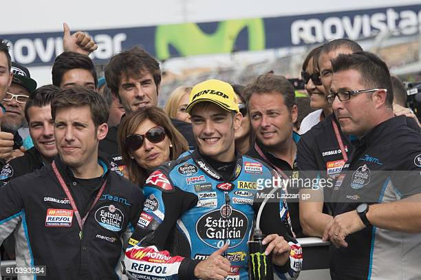 Jorge Navarro of Spain and Estrella Galicia 00 celebrates the victory with team under the podium at the end of the Moto3 race during the MotoGP of...