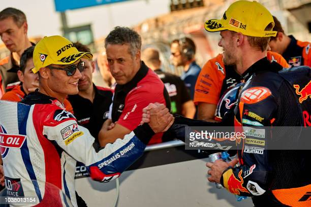 Jorge Navarro of Spain and Federal Oil Gresini Moto2 Kalex and Marcel Schrotter of Germany and Dynavolt Intact GP Kalex during qualifying for the...