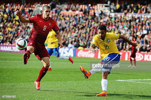 Jorge of Brazil kicks the ball past Andre Silva of Portugal during the FIFA U20 World Cup New Zealand 2015 quarter final match between Brazil and...