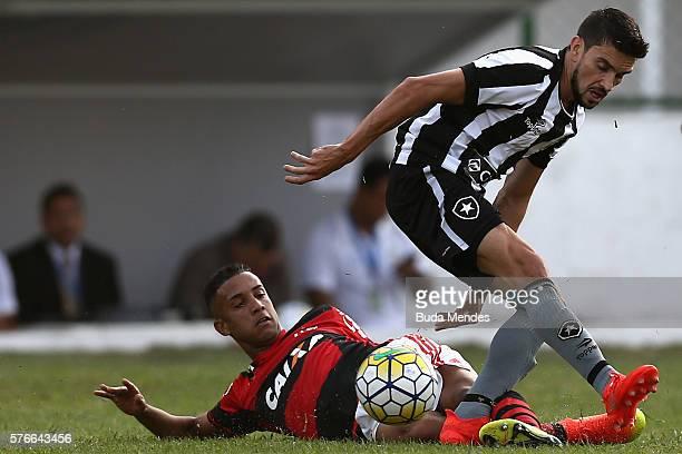Jorge of Flamengo struggles for the ball with Rodrigo Pimpao of Botafogo during a match between Flamengo and Botafogo as part of Brasileirao Series A...