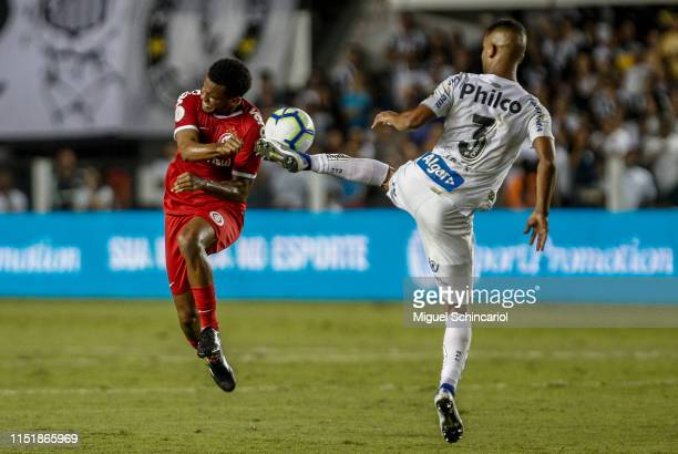 Jorge of Santos competes for the ball with Rithely of Internacional during a match between Santos and Internacional for the Brasileirao Series A 2019...
