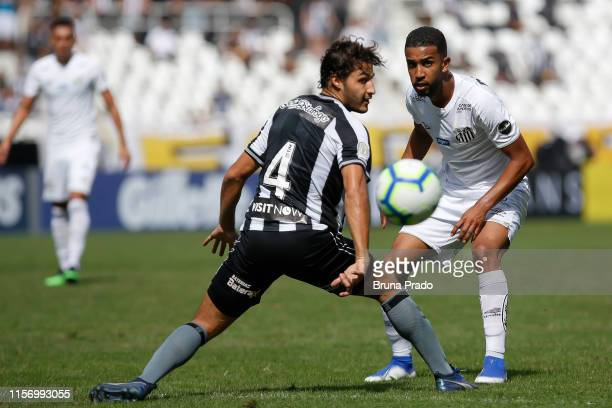 Jorge of Santos struggles for the ball with a Marcinho of Botafogo during a match between Botafogo and Santos as part of Brasileirao Series A 2019 at...