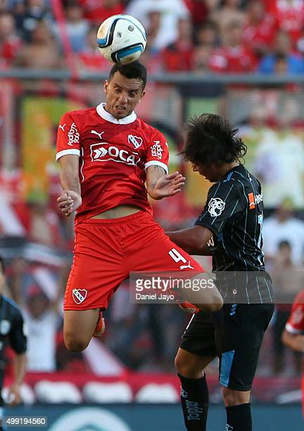 Jorge Ortiz of Independiente and Oscar Romero of Racing Club go for a header during a first leg match between Independiente and Racing Club as part...