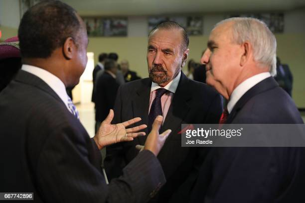 Jorge Perez CEO Related Urban Group and Carlos Gimenez mayor of MiamiDade speak with US Housing and Urban Development Secretary Ben Carson during a...